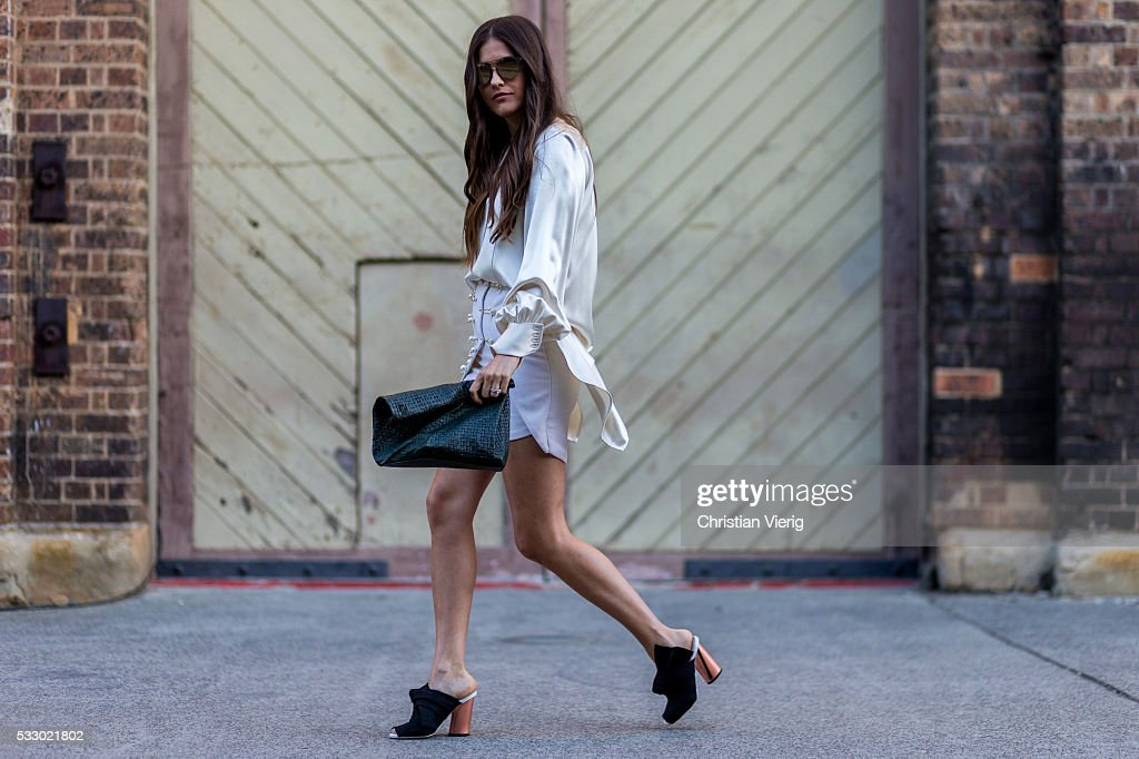 Paola Alberdi wearing a white Ellery shirt, mini skirt, vintage clutch and black Proenza Schouler shoes at Mercedes-Benz Fashion Week Resort 17 Collections at Carriageworks on May 20, 2016 in Sydney, Australia.