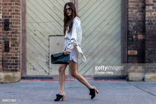 Paola Alberdi wearing a white Ellery shirt mini skirt vintage clutch and black Proenza Schouler shoes at MercedesBenz Fashion Week Resort 17...