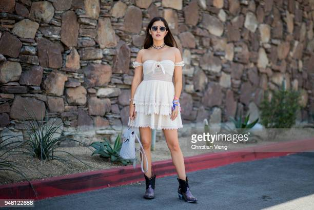 Paola Alberdi wearing House of Harlow 1960 dress is seen on April 13, 2018 in Indio, California.