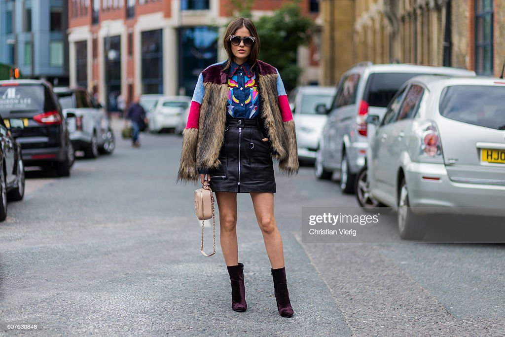 Paola Alberdi wearing Jimmy Choo sunglasses, a MSGM fur jacket, Tsumori Chisato button shirt, Isabel Marant leather skirt, Chanel bag outside Topshop during London Fashion Week Spring/Summer collections 2017 on September 18, 2016 in London, United Kingdom.