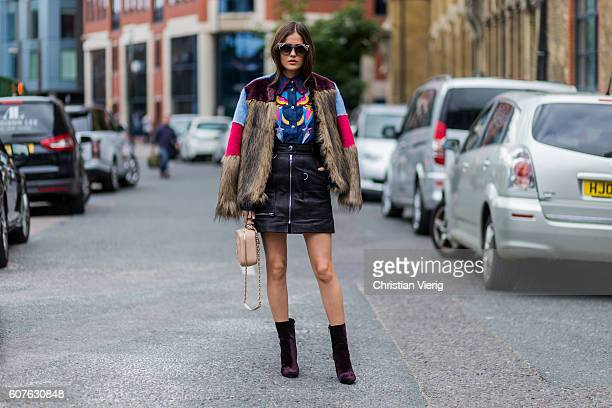 Paola Alberdi wearing Jimmy Choo sunglasses, a MSGM fur jacket, Tsumori Chisato button shirt, Isabel Marant leather skirt, Chanel bag outside Topshop...