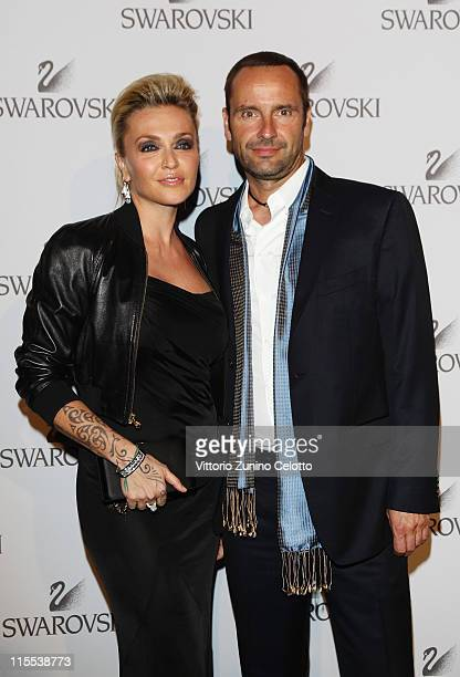 Paola Barale and Swarovski CEO Robert Buchbauer attend the Swarovski Fashionation at Palazzo Reale on June 7 2011 in Milan Italy