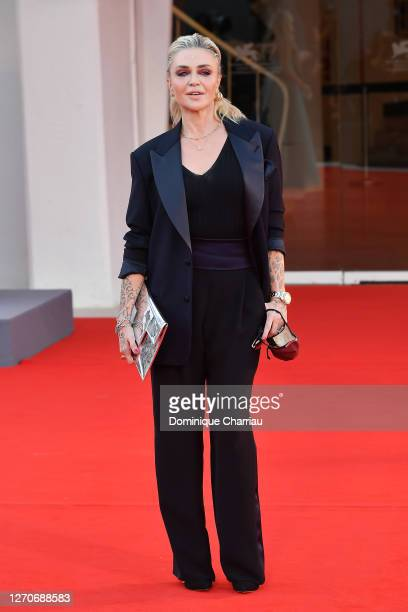 """Paola Barale walks the red carpet ahead of the movie """"Padrenostro"""" at the 77th Venice Film Festival at on September 04, 2020 in Venice, Italy."""