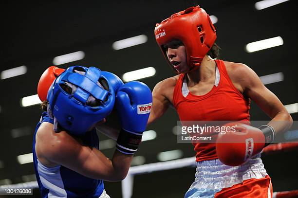 Paola Benavides of Argentina with Mandy Bujold of Canada during the semifinal of 4851 Kg Women's flyweight in the 2011 Pan American Games Guadalajara...