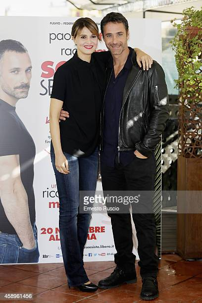 Paola Cortellesi and Raoul Bova attends the 'Scusate Se Esisto' photocall at Cinema Barberini on November 14 2014 in Rome Italy
