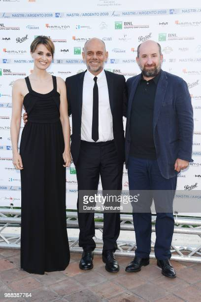 Paola Cortellesi, Riccardo Milani and Antonio Albanese attend the Nastri D'Argento cocktail party on June 30, 2018 in Taormina, Italy.