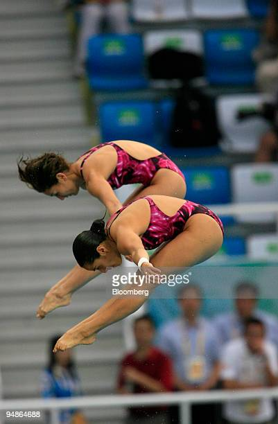 Paola Espinosa left and Tatiana Ortiz of Mexico hold a pike position women's 10meter synchronized diving event during day four of the 2008 Beijing...