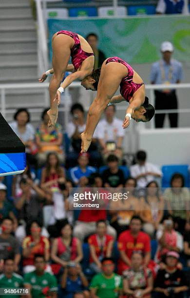Paola Espinosa left and Tatiana Ortiz of Mexico hold a pike position in the women's 10meter synchronized diving event during day four of the 2008...