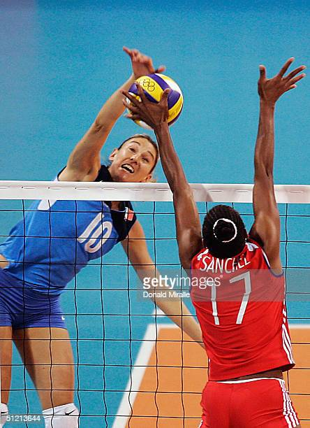 Paola Paggi of Italy goes up for a spike against Marta Sanchez Salfran of Cuba goes during Italy's 23 loss to Cuba in the women's indoor Volleyball...