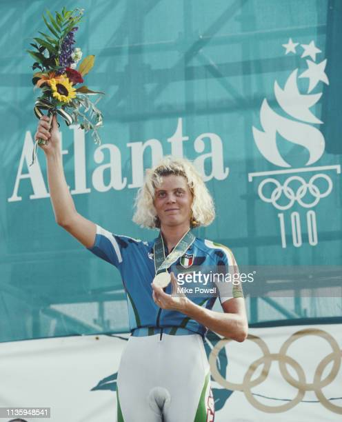 Paola Pezzo of Italy celebrates on the podium with her Gold medal after winning the inaugural Women's Mountain Bike CrossCountry Race on 30 July 1996...