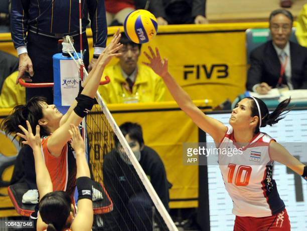 Paola Ramirez Vargas of Costa Rica pushes the ball against Mai Yamaguchi of Japan during their first round match of the women's volleyball world...