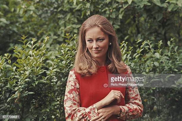 Paola Ruffo di Calabria later Queen Paola of Belgium posed wearing a red pinafore dress in a garden in Belgium on 18th June 1969