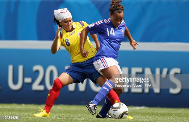 Paola Sanchez of Colombia battles for the ball with Ines Jaurena of France during the FIFA U20 Women's World Cup Group A match between Colombia and...