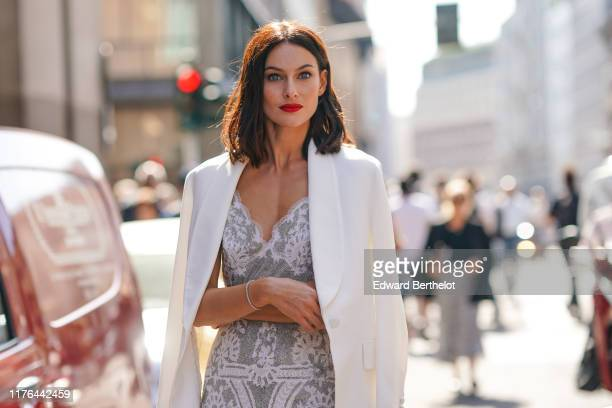 Paola Turani attends the Ermanno Scervino show at Milan Fashion Week Spring Summer 2020 on September 21 2019 in Milan Italy
