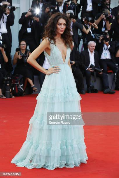 Paola Turani walks the red carpet ahead of the opening ceremony and the 'First Man' screening during the 75th Venice Film Festival at Sala Grande on...