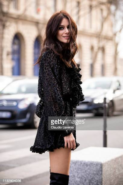 Paola Turani wearing a black decorated mini dress and black over the knees boots is seen outside Redemption on Day 4 Paris Fashion Week Autumn/Winter...