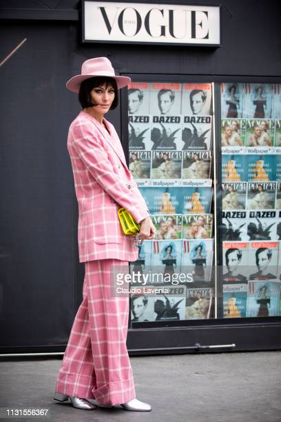 Paola Turani wearing a pink hat yellow seethrough Chanel bag and pink tailleur is seen on Day 4 Milan Fashion Week Autumn/Winter 2019/20 on February...
