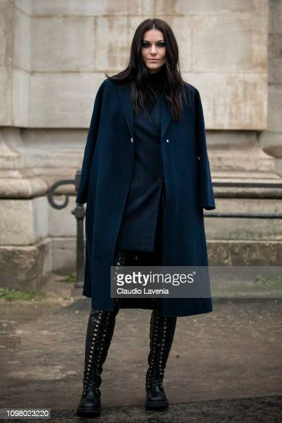 Paola Turani wearing blue long coat and black boots is seen outside Alexandre Vauthier during Paris Fashion Week Haute Couture Spring Summer 2019 on...