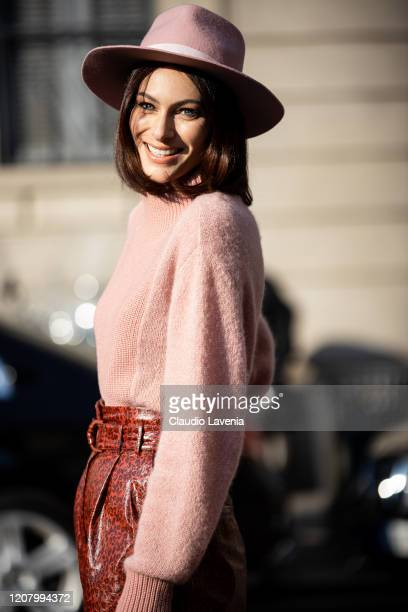 Paola Turani wearing pink hat pink pullover and red snakeskin pants is seen outside Salvatore Ferragamo show during Milan Fashion Week Fall/Winter...