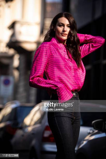 Paola Turani wearing purple shirt is seen outside Blumarine on Day 3 Milan Fashion Week Autumn/Winter 2019/20 on February 22 2019 in Milan Italy