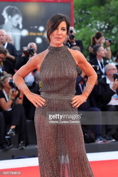 Paola Turci walks the red carpet ahead of the 'CapriRevolution' screening during the 75th Venice Film Festival at Sala Grande on September 6 2018 in...