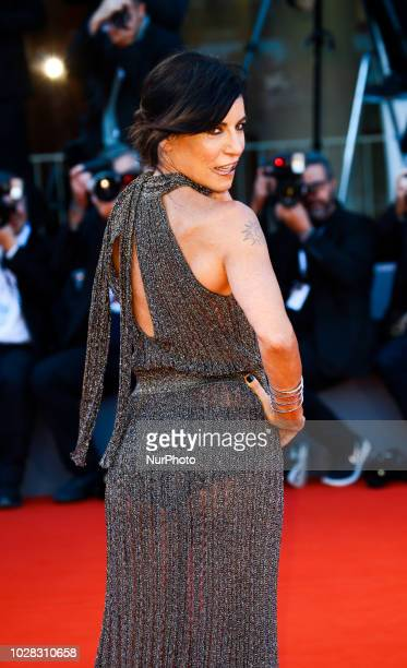 Paola Turci walks the red carpet ahead of the 'Capri-Revolution' screening during the 75th Venice Film Festival on September 6, 2018 in Venice, Italy.