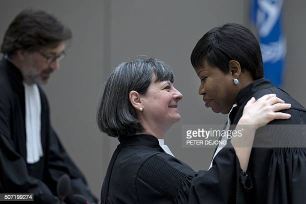 Paolina Massidda legal representative of the victims greets prosecutor Fatou Bensouda as they wait for the start Ivory Coast president Laurent Gbagbo...