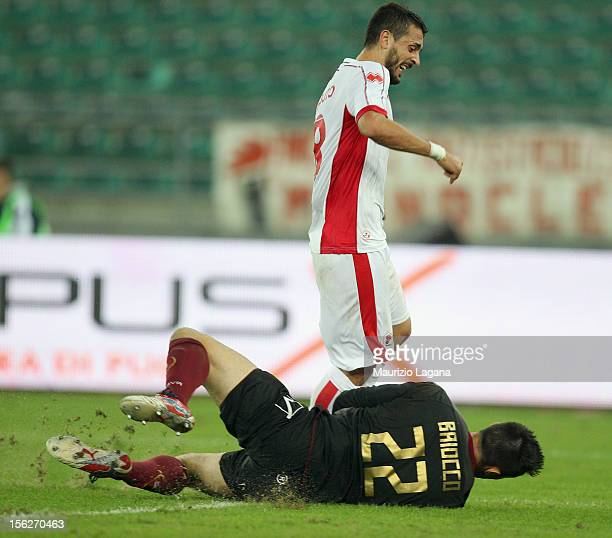 Paolo Baiocco of Reggina competes for the ball with Francesco Caputo of Bari during the Serie B match between AS Bari and Reggina Calcio at Stadio...