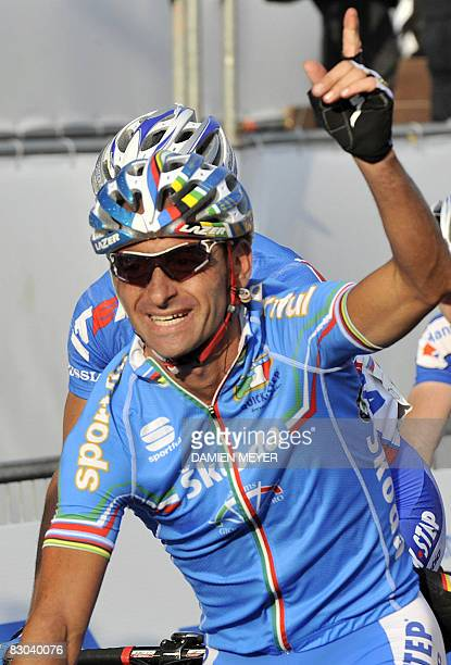 Paolo Bettini of Italy waves to the crowd as he finishes the elite men road race at the 2008 UCI road world championships in Varese on September 28,...