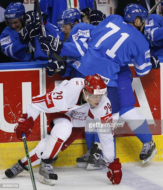 Paolo Bustreo and Luca Ansoldi of Italy collide while Morten Madsen of Denmark slips out of a hit in the third period during the preliminary round at...