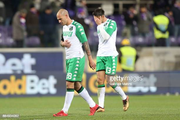 Paolo Cannavaro and Federico Peluso of US Sassuolo Calcio shows his dejection during the Serie A match between ACF Fiorentina and US Sassuolo at...