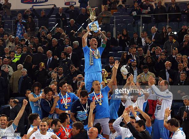 Paolo Cannavaro captain of SSC Napoli holds the trophy after winning the Tim Cup final match against Juventus FC at Olimpico Stadium on May 20, 2012...