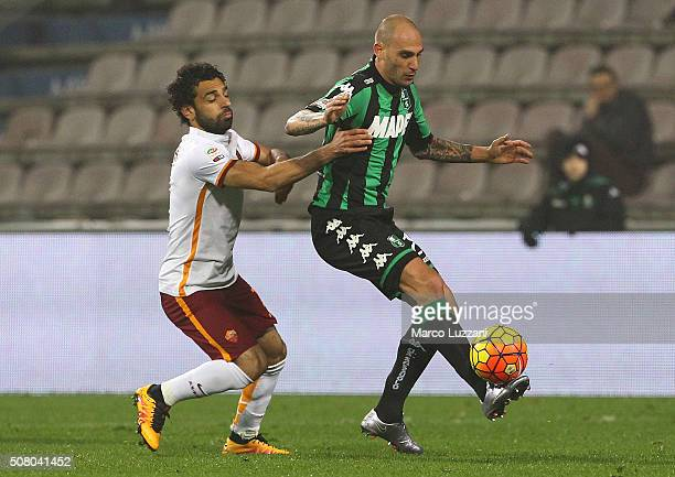 Paolo Cannavaro of US Sassuolo Calcio is challenged by Mohamed Salah of AS Roma during the Serie A match between US Sassuolo Calcio and AS Roma at...