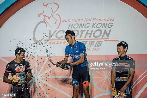 Paolo Caputo Fu Shiu Cheung and Dor Ming Domino Chau celebrate on stage during the Sun Hung Kai Properties Hong Kong Cyclothon on October 10 2015 in...