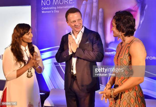 Paolo Colella India Head Ericsson greets to Phogat Sisters Geeta and Babita on the occasion International Women's Day at a function in Ericsson Forum...