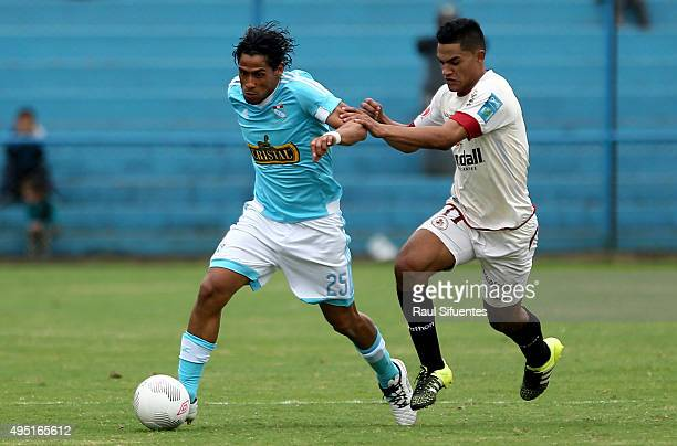 Paolo de la Haza of Sporting Cristal fights for the ball with Anderson Santamaria of Leon de Huanuco during a match between Sporting Cristal and Leon...