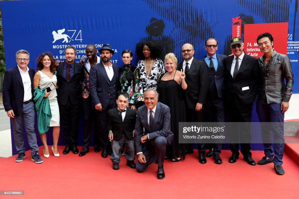 Paolo Del Brocco, Maria Chiara Augenti, Claudio Santamaria, Narcisse Mame, Marco D'Amore, Sara Serraiocco, Simoncino, Alberto Barbera, Aline Belibi, guest, Cosimo Gomez and Yang Shi (L) walks the red carpet ahead of the 'Brutti E Cattivi' screening during the 74th Venice Film Festival at Sala Darsena on September 7, 2017 in Venice, Italy.