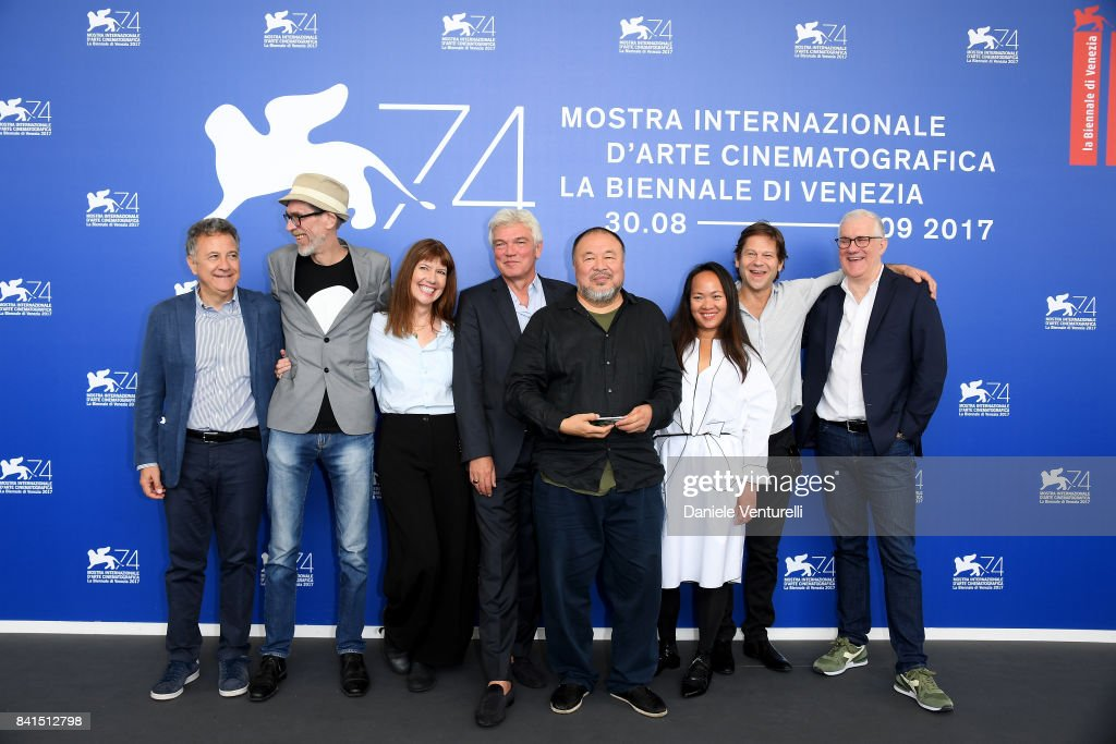 Paolo Del Brocco, Niels Pagh Andersen, Diane Weyermann, Christopher Doyle, Ai Weiwei and guests attend the 'Human Flow' photocall during the 74th Venice Film Festival on September 1, 2017 in Venice, Italy.