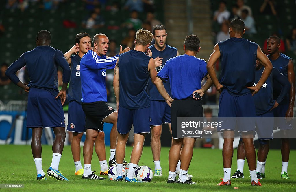 Paolo Di Canio coach of Sunderland talks to the players during a Sunderland Barclays Asia Trophy training session at Hong Kong Stadium on July 23, 2013 in So Kon Po, Hong Kong.