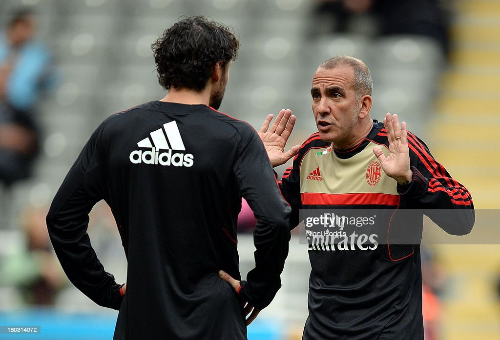 Paolo Di Canio (R) of AC Milan Glorie is seen chatting to a teammate ahead of the Steve Harper testimonial match between Newcastle United and AC Milan Glorie at St James' Park on September 11, 2013 in Newcastle upon Tyne, England.