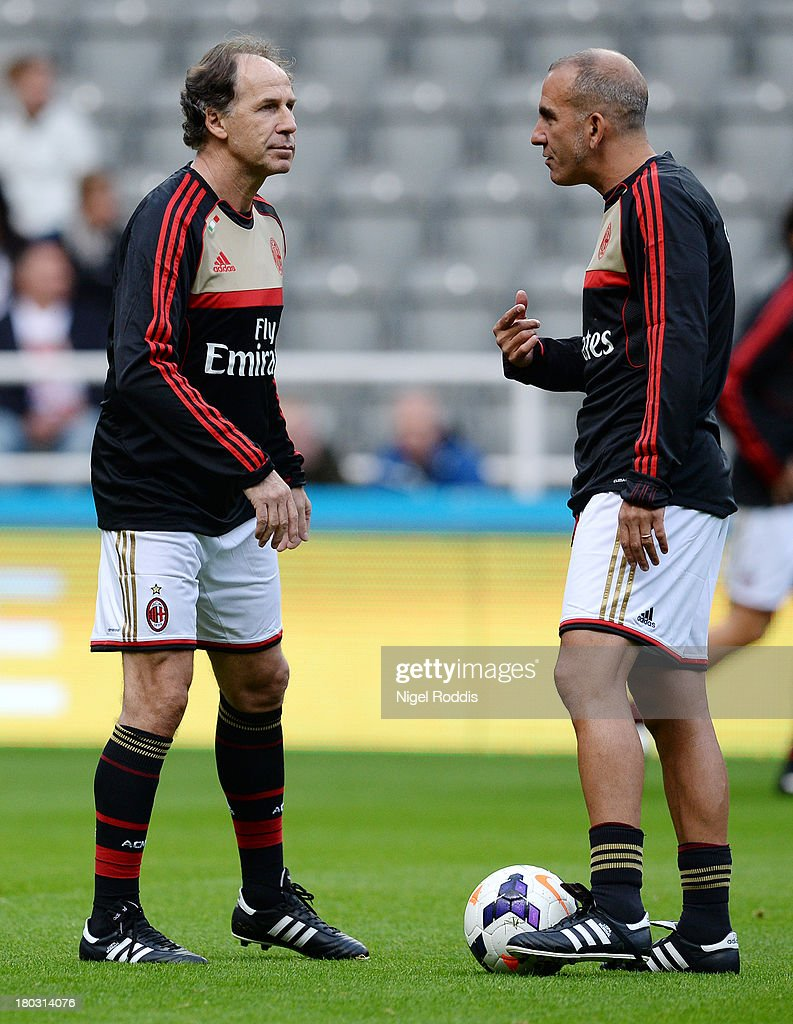 Paolo Di Canio (R) of AC Milan Glorie is seen chatting to Franco Baresi ahead of the Steve Harper testimonial match between Newcastle United and AC Milan Glorie at St James' Park on September 11, 2013 in Newcastle upon Tyne, England.