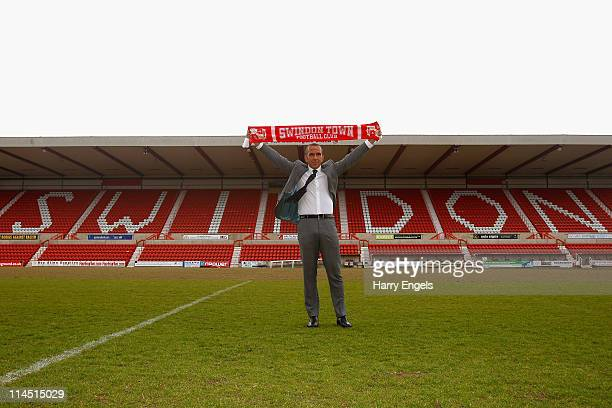 Paolo di Canio poses for photographers during a press conference to announce his arrival as manager of Swindon Town FC at County Ground on May 23,...