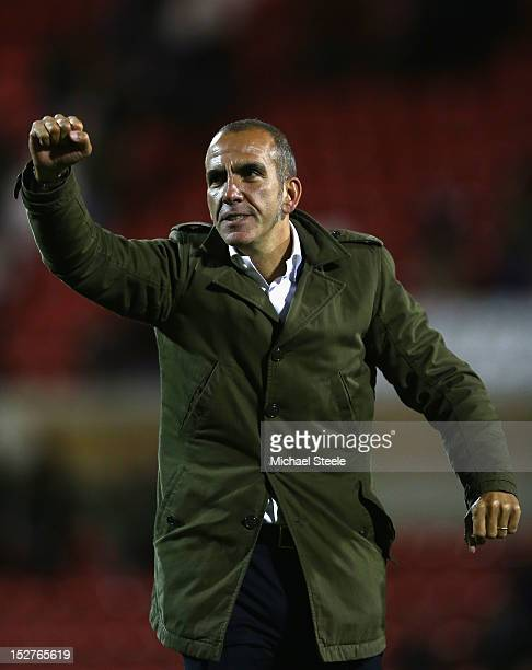 Paolo Di Canio the manager of Swindon Town acknowledges the crowd after his sides 3-1 victory during the Capital One Cup Third Round match between...