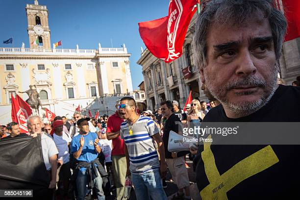 Paolo Di Vetta leader of movement for the right to housing Protesters of the Movements for the right to protest in the square of the Capitol After...