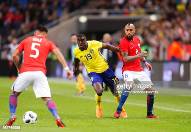 Paolo Diaz of Chile Ken Sema of Sweden and Arturo Vidal of Chile during the International Friendly match between Sweden and Chile at Friends arena on...