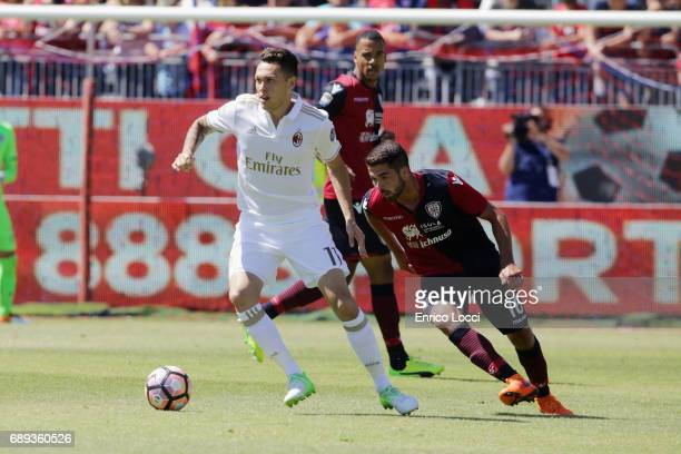Paolo Faragò of Cagliari contrast Lucas Ocampos of Milan during the Serie A match between Cagliari Calcio and AC Milan at Stadio Sant'Elia on May 28...