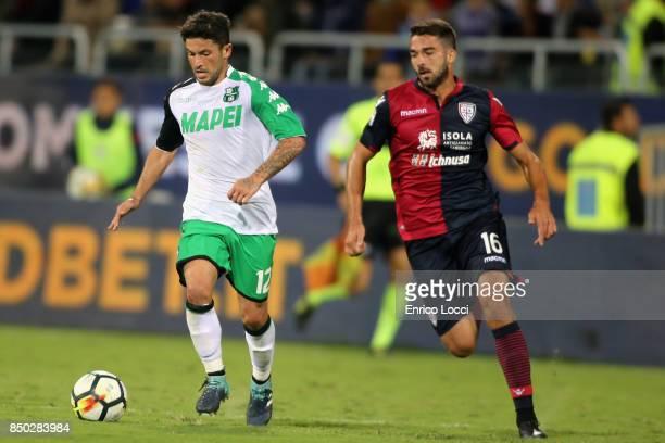 Paolo Faragò of Cagliari in contrast with Federico Peluso of Sassuolo during the Serie A match between Cagliari Calcio and US Sassuolo at Sardegna...