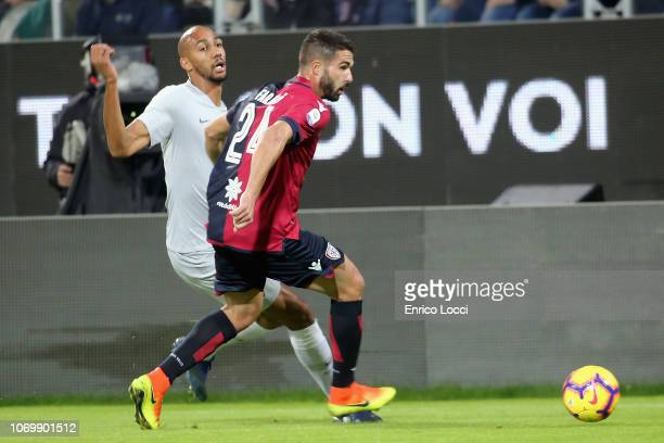 Paolo Faragò of Cagliari in contrast with Steven Nzonzi of Roma during the Serie A match between Cagliari and AS Roma at Sardegna Arena on December 9...