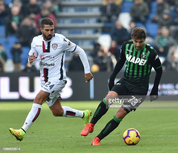 Paolo Farago' of Cagliari and Manuel Locatelli of US Sassuolo in action during the Serie A match between US Sassuolo and Cagliari at Mapei Stadium...