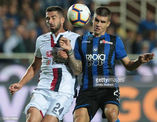 Paolo Farago of Cagliari Calcio competes for the ball with Gianluca Mancini of Atalanta BC during the serie A match between Atalanta BC and Cagliari...